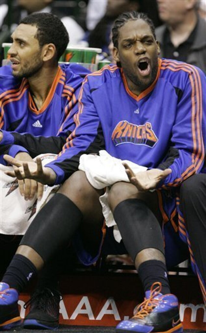 New York Knicks center Eddy Curry, right, sits on the bench in the second half of an NBA basketball game against the Dallas Mavericks in Dallas, Thursday, Jan. 8, 2009. Curry played in his first game of the season Thursday night against the Dallas Mavericks. (AP Photo/Donna McWilliam)