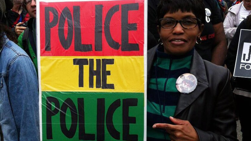 """The homemade """"Police the Police"""" poster carried by Beverly Adams of University City, Mo., during an October protest will be on display at the Newseum in Washington, D.C."""