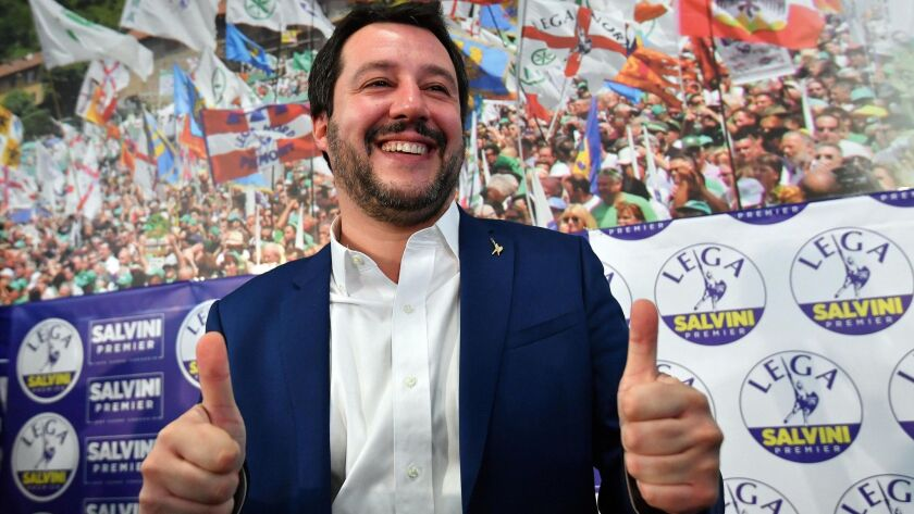 Matteo Salvini, leader of the right-wing, anti-immigrant League party, celebrates at a news conference on Monday.