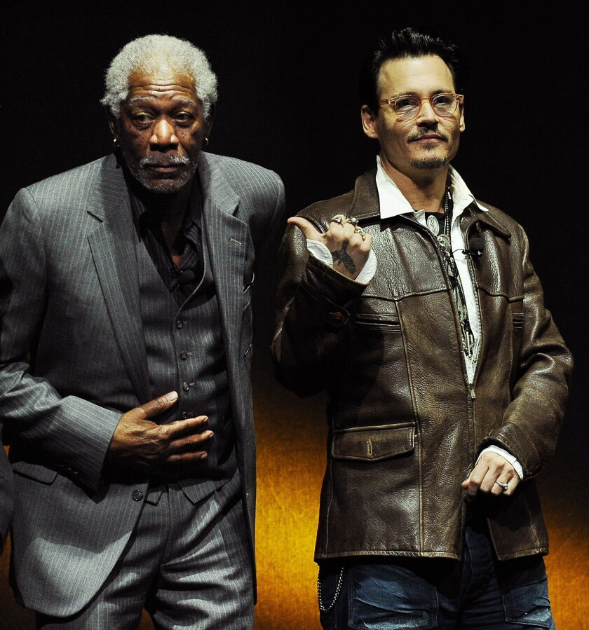 """Johnny Depp, right, confirmed engagement rumors in his own roundabout way during a promotional appearance for his upcoming film """"Transcendence"""" in Beijing on Monday. In this photo, Depp, wearing said ring, appears with his Transcendence"""" costar Morgan Freeman during the Warner Bros. presentation at CinemaCon 2014 in Las Vegas."""