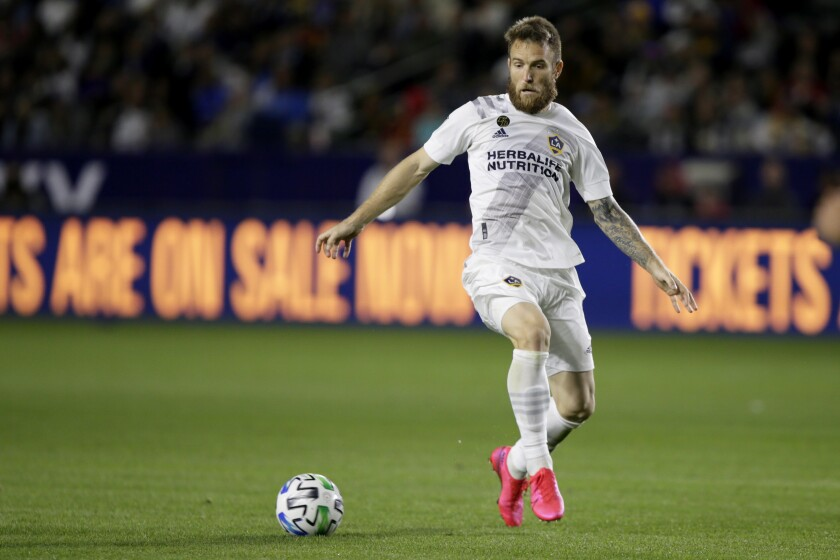 """FILE - In this March 7, 2020, file photo, LA Galaxy forward Aleksandar Katai controls the ball against the Vancouver Whitecaps during the second half of an MLS soccer match in Carson, Calif. The Galaxy will meet with Katai on Thursday, June 4, to discuss a series of alarming social media posts by his wife. Tea Katai made the since-deleted posts on her Instagram Story this week, the Galaxy confirmed Wednesday night in a statement. The team will meet with Katai to """"determine next steps."""" (AP Photo/Alex Gallardo, File)"""