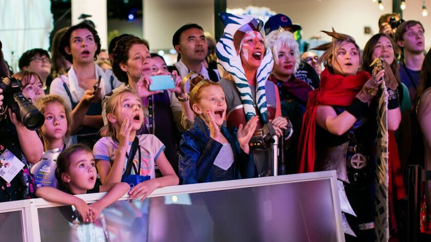 A crowd watches a fashion show at a Disney event in Anaheim, which saw a record 24.2 million visitors last year.