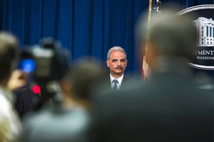 Holder defends subpoena of journalists' phone records