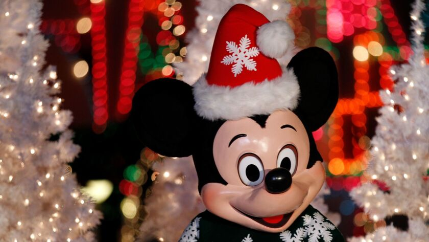 """Mickey Mouse appears during the lighting of """"It's a Small World"""" ride, decorated for the holiday season on Nov. 12, 2015 at Disneyland in Anaheim."""