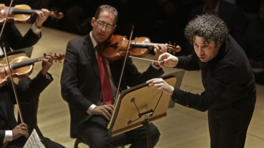 Gustavo Dudamel conducting the LA Phil, the Simón Bolívar Symphony and Los Angeles Master Chorale in Beethoven's 9th Symphony at Walt Disney Concert Hall in on Oct. 4, 2015.