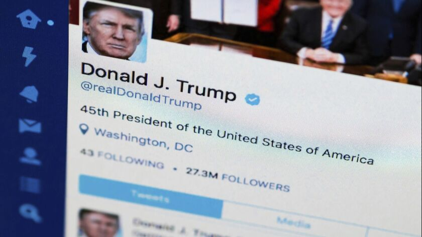 FILE - This April 3, 2017, file photo shows U.S. President Donald Trump's Twitter feed on a computer