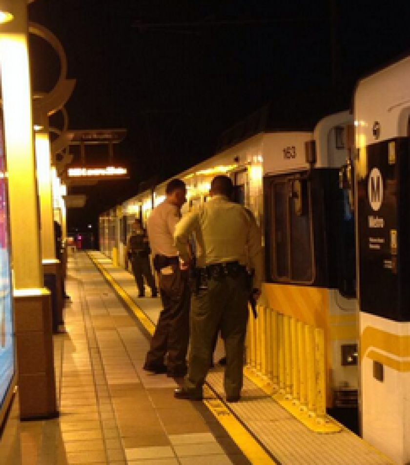 Deputies search the Metro Blue Line after someone reported three juveniles armed with guns Tuesday. No weapons were found.