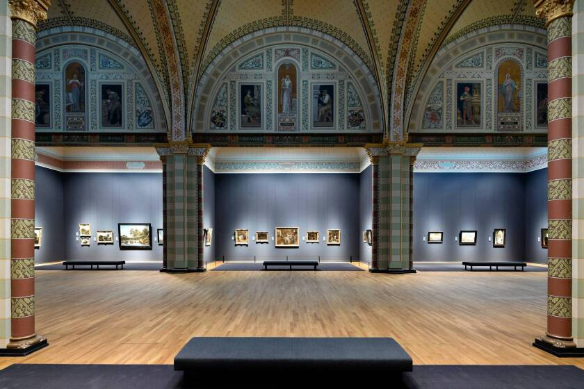 The Gallery of Honor remains the Rijksmuseum's focal point, with chapel-like side galleries featuring old master works and a stained glass entrance hall.