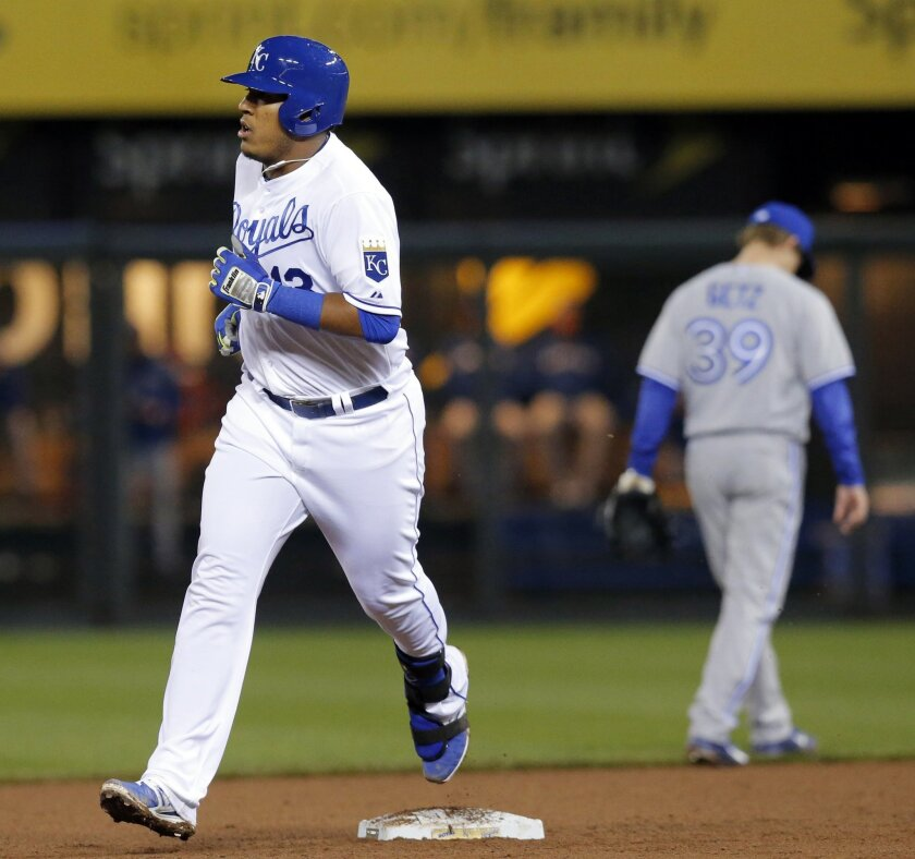 Kansas City Royals' Salvador Perez rounds the bases after his two-run home run during the seventh inning of a baseball game against the Toronto Blue Jays in Kansas City, Mo., Tuesday, April 29, 2014. (AP Photo/Orlin Wagner)