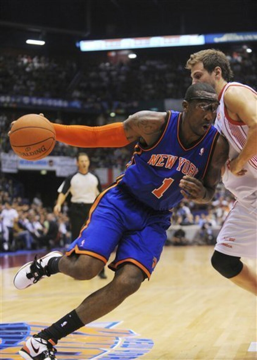 New York Knicks forward Amar'e Stoudemire in action during the New York Knicks' preseason opener against Italian team Olimpia Milano. in Milan, Italy, Sunday, Oct. 3, 2010. (AP Photo/Claudio Scaccini)