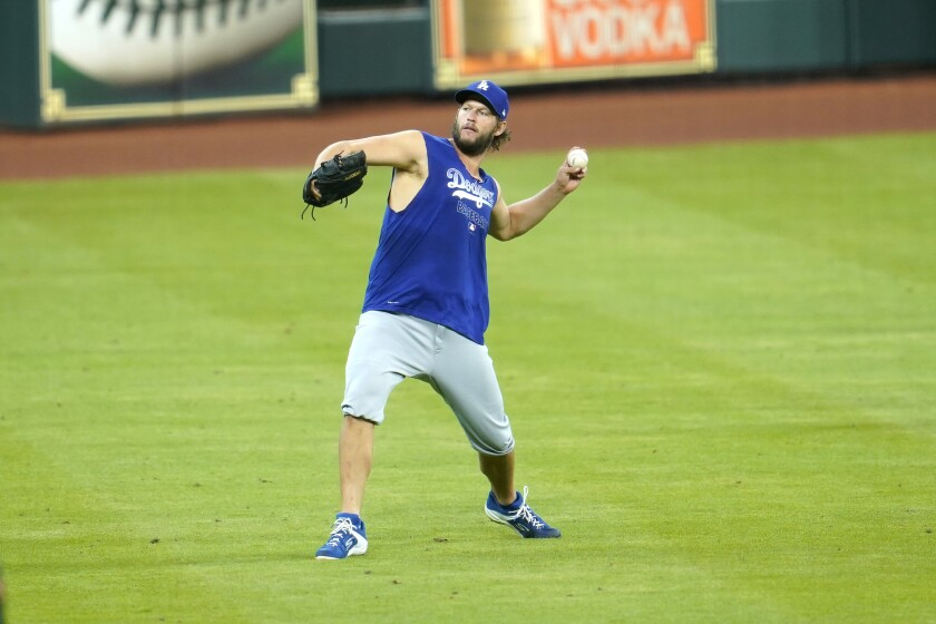 Dodgers pitcher Clayton Kershaw throws in the field during batting practice before a game against Houston on July 29, 2020.