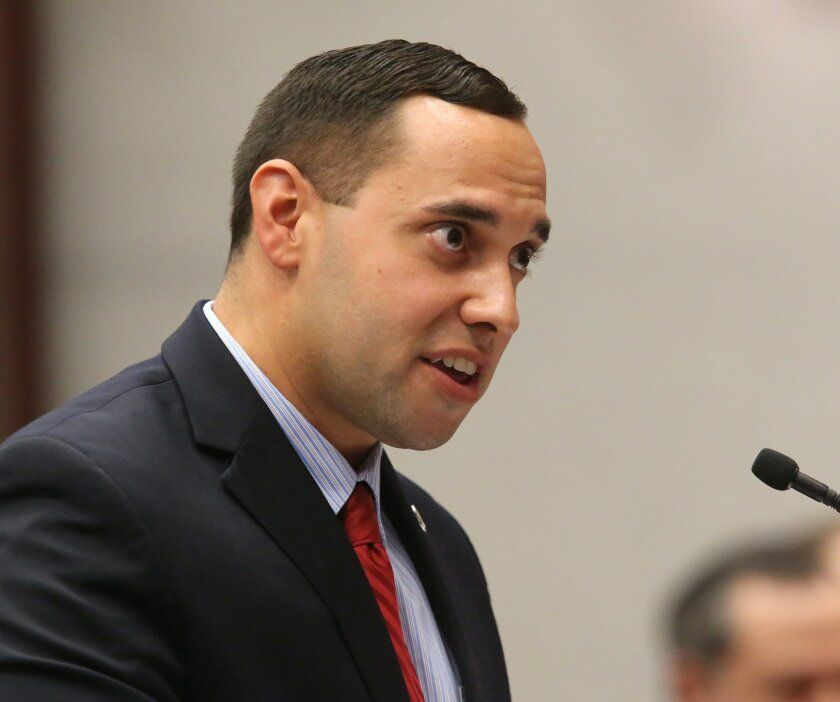 FILE - In this Tuesday, April 14, 2015, file photo, Rep. Bryan Avila, R-Hialeah, presents a bill dealing with powdered alcohol during a house regulatory affairs committee meeting, in Tallahassee, Fla. The creator of powdered alcohol, Mark Phillips, is trying to fend off efforts to ban the product i