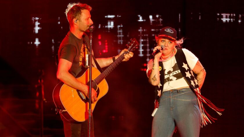 """Dierks Bentley performs with Elle King on his hit """"Different for Girls"""" Friday at the Stagecoach country music festival in Indio."""
