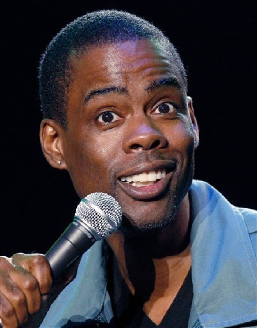 In this June 13, 2008 file photo, Chris Rock performs at the Bonnaroo Music and Arts Festival 2008 in Manchester, Tenn.  (AP Photo/Bill Waugh, file)