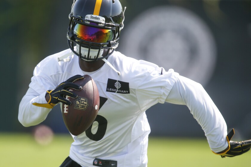 Pittsburgh Steelers running back Le'Veon Bell (26) carries the ball during NFL football practice in Pittsburgh. When healthy, Bell is one of the most dynamic backs in the league.
