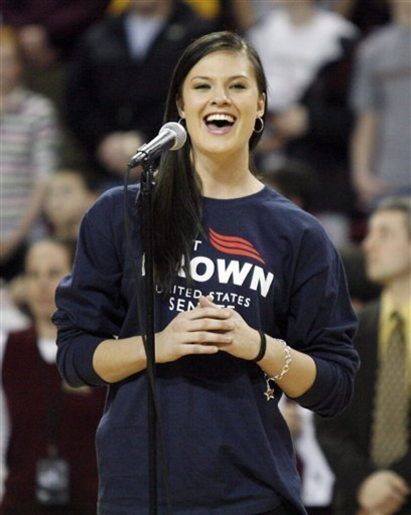 """FILE - In this Jan. 16, 2010, file photo Boston College women's basketball player Ayla Brown sings the National Anthem before the start of a men's NCAA college basketball game between Boston College and Maryland in Boston. On ABC's This Week Sunday, Jan. 31, 2010, Sen.-elect Scott Brown said he'd like his daughter Ayla to have another crack at """"American Idol."""" The fledgling recording artist, a 21-year-old student at Boston College, made it to the show's final 16 singers in 2006. (AP Photo/Mary Schwalm)"""