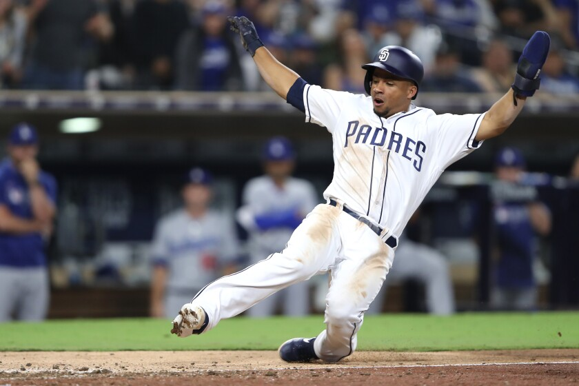 Francisco Mejia scores on a wild pitch during the ninth inning of the Padres' game against the Los Angeles Dodgers on Wednesday at Petco Park.