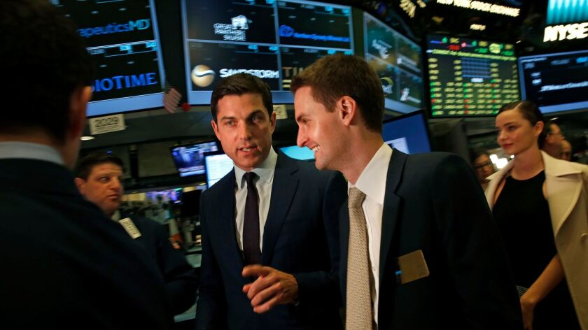 Snap Inc. Chief Executive Evan Spiegel, right, enters the trading floor before he rings the bell at the New York Stock Exchange for its Wall Street debut.