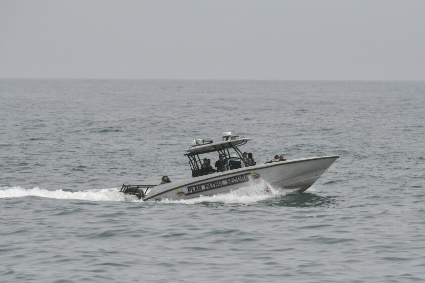Security forces patrol by boat off La Guaira, Venezuela