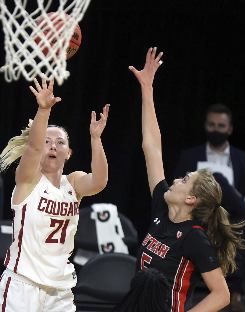 Washington State guard Johanna Teder (21) shoots as Utah forward Zuzanna Puc (5) defends during an NCAA college basketball game in the first round of the Pac-12 women's tournament Wednesday, March 3, 2021, in Las Vegas. (AP Photo/Isaac Brekken)