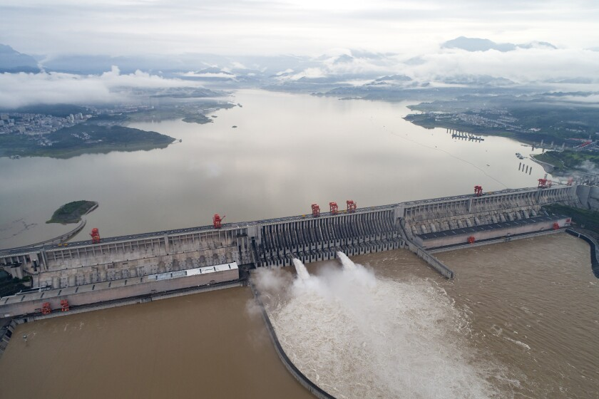 Water flows out from the Three Gorges Dam on the Yangtze River