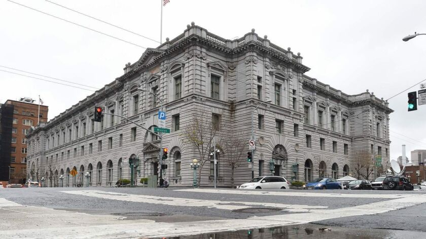 A federal appeals court panel Tuesday struck down as overly broad a federal law that makes it a felony to encourage someone to violate immigration laws. Above, the 9th Circuit Court of Appeals in San Francisco.