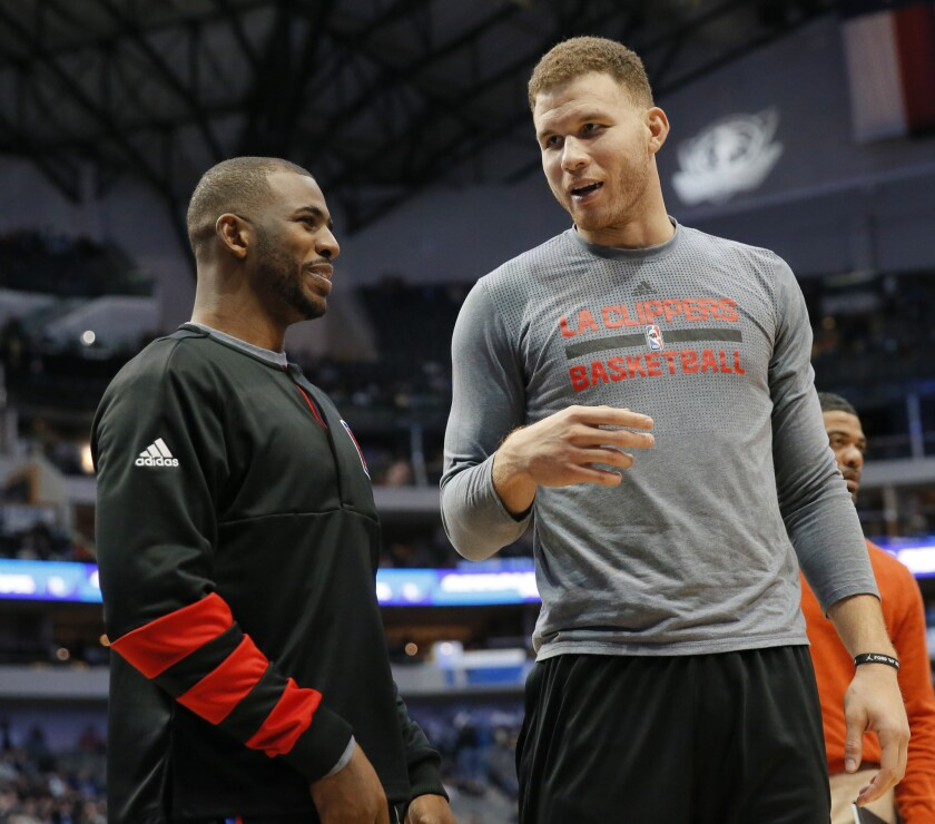 Clippers guard Chris Paul, left, and forward Blake Griffin talk on the baseline during a game against the Dallas Mavericks on Nov. 23, 2016.