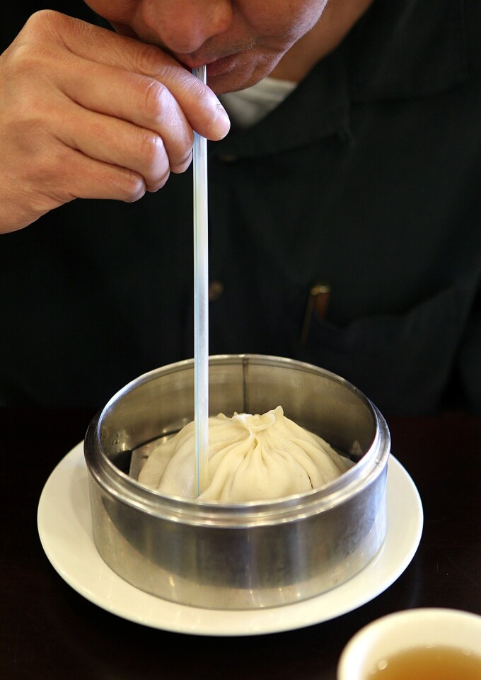 A soup dumpling the size of a softball requires a straw at Wang Xing Ji.