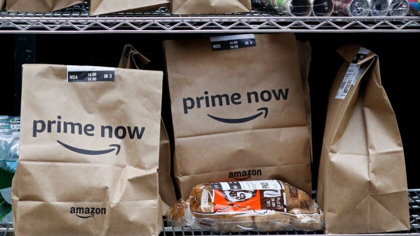 Amazon Prime Now bags sit ready for delivery at a warehouse in New York.