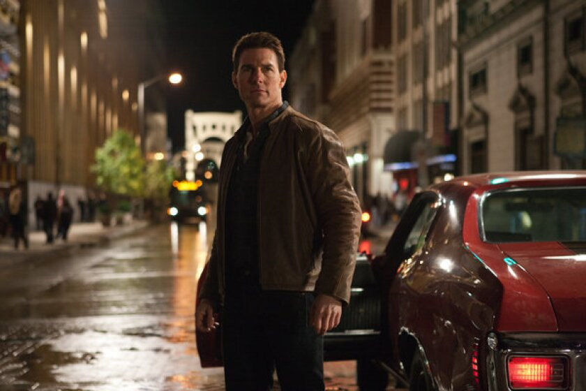 """Tom Cruise in a scene from """"Jack Reacher."""" Cruise plays a former military cop investigating a sniper case. Paramount has postponed the premiere of """"Jack Reacher"""" scheduled for Saturday, Dec. 15, in Pittsburgh, due to the Sandy Hook Elementary School shooting in Newtown, Conn."""