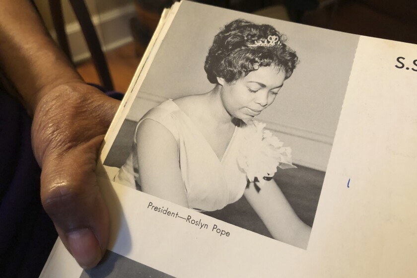 """In this March 4, 2020 photo, Roslyn Pope shows her Spelman College yearbook at her home in Atlanta. As a 21-year-old Spelman senior in March 1960, Pope wrote """"An Appeal for Human Rights,"""" a document that made the case for the Atlanta Student Movement, a nonviolent campaign of boycotts and sit-ins by black college students that protested racial segregation in education, jobs, housing, voting, hospitals, movies, concerts, restaurants and law enforcement. (AP Photo/Michael Warren)"""