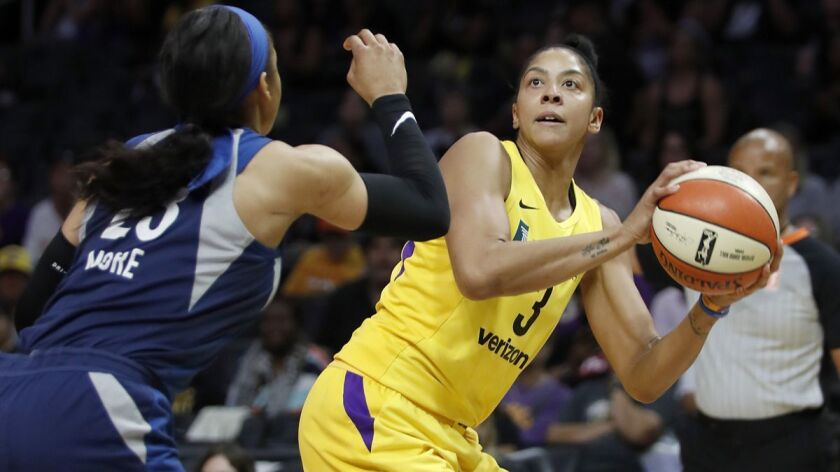 Sparks center Candace Parker shoots against Minnesota Lynx forward Maya Moore in the first quarter of an WNBA playoff game at Staples Center on Tuesday.