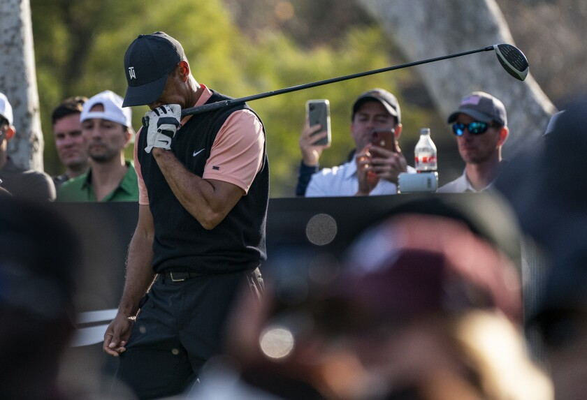 Tiger Woods reacts after hitting a stray tee during the first round of the Genesis Invitational on Feb. 13, 2020.