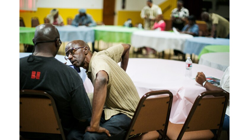 Melvin Farmer, a former gang member, attends a gang violence prevention meeting in 2015.