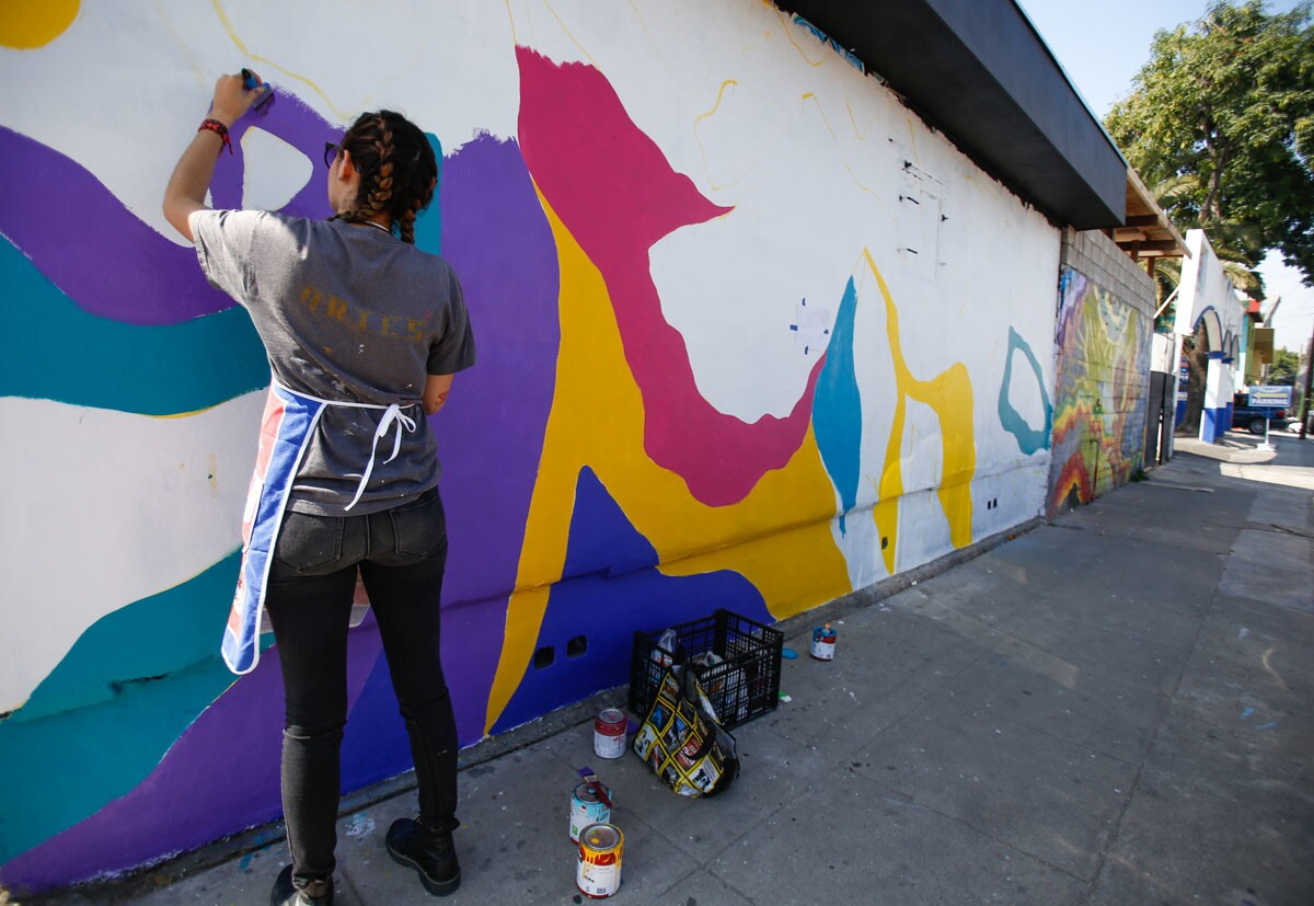 Various locations of Tijuana for PACIFIC. Studio 664 in Colonia Revolucion has art inside and murals outside the building. On the left Artist Egle Trevilla paints a mural outside with Studio 664 director Katia Sanay Vigiola on the right. | Alejandro Tamayo