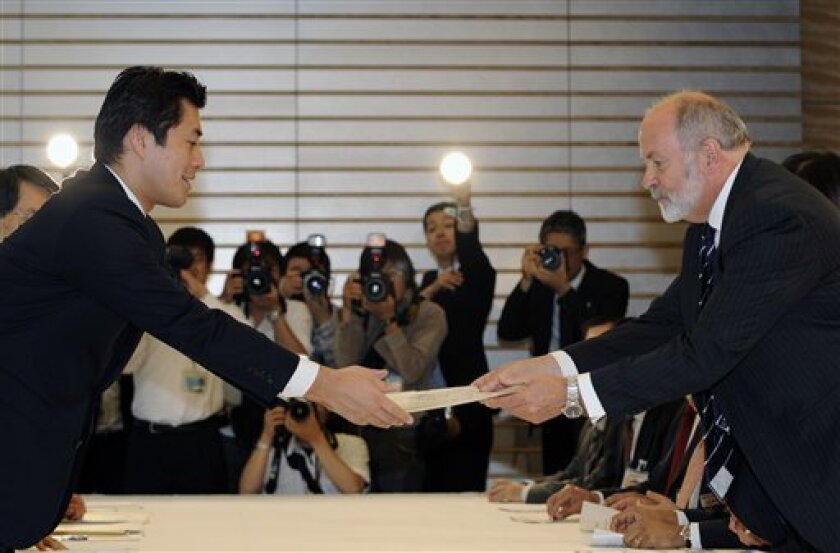 International Atomic Energy Agency, or IAEA fact-finding team leader Mike Weightman, right, of Britain gives a summary report on the accident at the Fukushima Dai-ichi nuclear power station to Goshi Hosono, special adviser to Prime Minister Naoto Kan, at prime minister's official residence in Tokyo, Japan Wednesday, June 1, 2011. The experts wrapped up an onsite investigation at the crippled Fukushima Dai-ichi nuclear power station. (AP Photo/Franck Robichon, Pool)