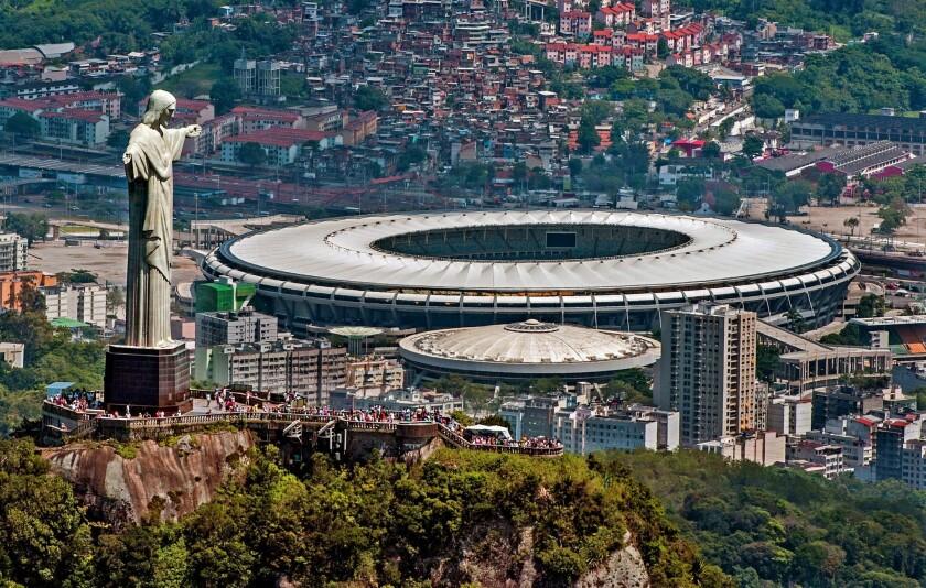 A statue of Christ the Redeemer atop Corcovado overlooks the Mário Filho (Maracanã) stadium in Rio de Janeiro. The Maracanã stadium will host both the Brazil 2014 FIFA World Cup and the 2016 Summer Olympics.
