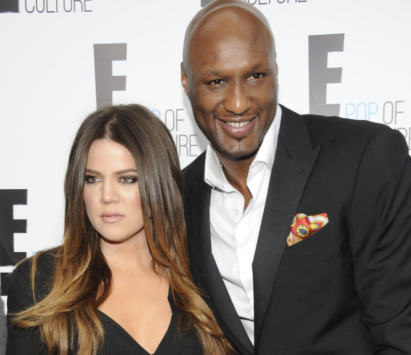 """FILE - In this April 30, 2012, file photo, Khloe Kardashian Odom and Lamar Odom from the show """"Keeping Up With The Kardashians"""" attend an E! Network upfront in New York. Kardashian filed for divorce from Odom for the second time on Thursday, May 26, 2016, citing irreconcilable differences. The pair married in September 2009 and broke up in late 2013, but Kardashian withdrew her first divorce petition after Odom was found unconscious at a Nevada brothel last year and required serious medical treatment. (AP Photo/Evan Agostini, File)"""