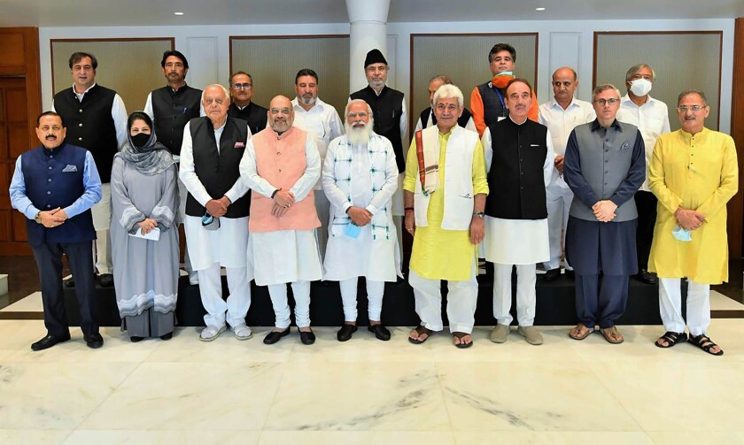 This photograph provided by the Prime Minister's Office shows members of various political parties with Indian Prime Minister Narendra Modi, center, and Home Minister Amit Shah, center left, in New Delhi, India, Thursday, June 24, 2021. India's prime minister is holding a crucial meeting with pro-India politicians from disputed Kashmir on Thursday for the first time since New Delhi stripped the region's semi-autonomy and jailed many of them in a crackdown. (Prime Minister's Office via AP)