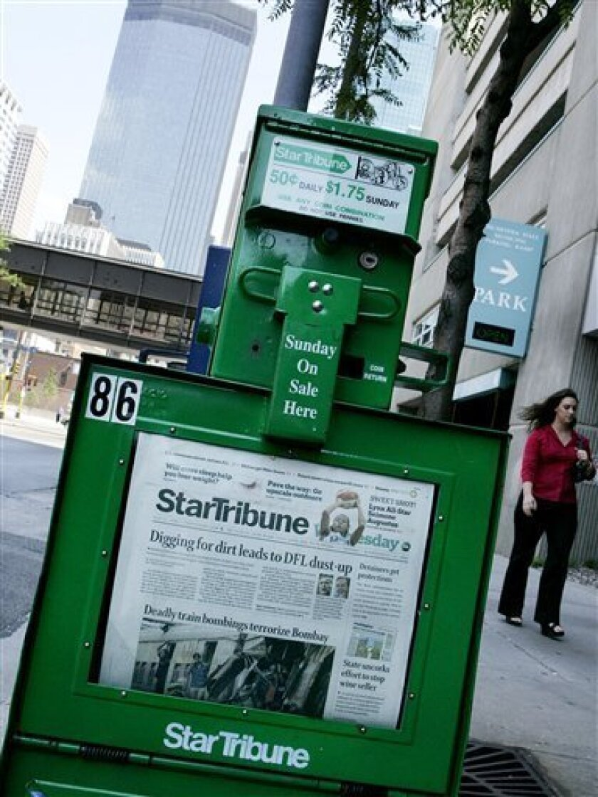 In this Wednesday, July 12, 2006 file photo, the Minneapolis skyline rises in the background of a Star Tribune newspaper vending machine. Less than two years after it was bought by a private equity group, the Star Tribune has filed for reorganization under Chapter 11 bankruptcy.   (AP Photo/Jim Mo