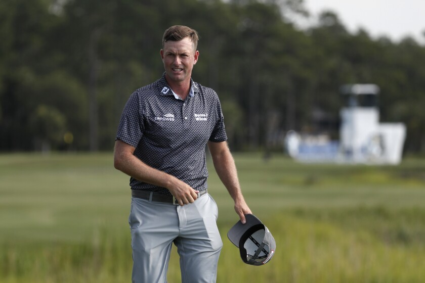 Webb Simpson walks off the 18th green after finishing his third round in the RBC Heritage on June 20, 2020.