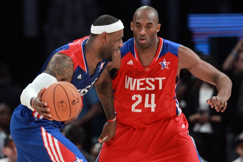 LeBron James drives against Kobe Bryant during the 2013 NBA All-Star game in Houston.