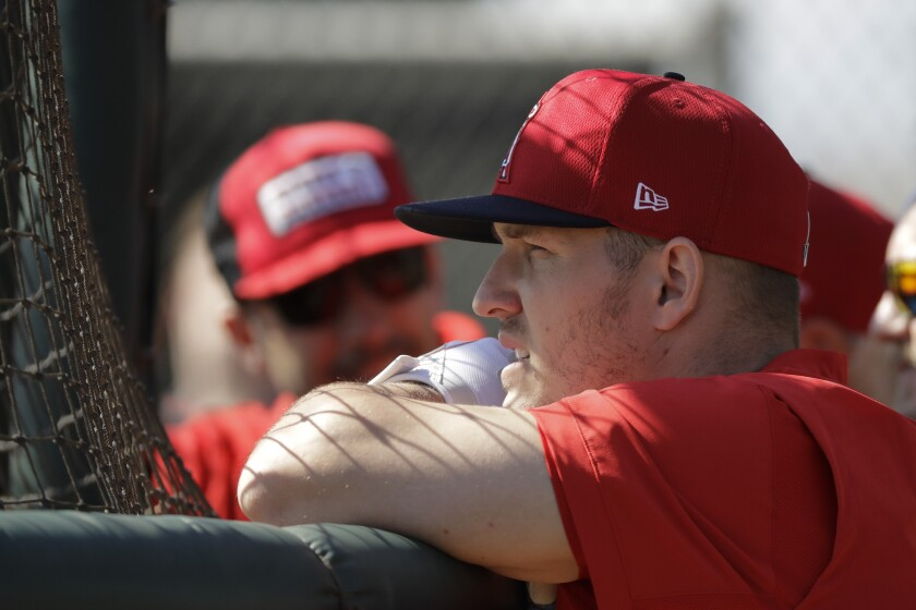 The Angels' Mike Trout watches batting practice during spring training baseball practice, Monday, Feb. 17, 2020, in Tempe, Ariz.