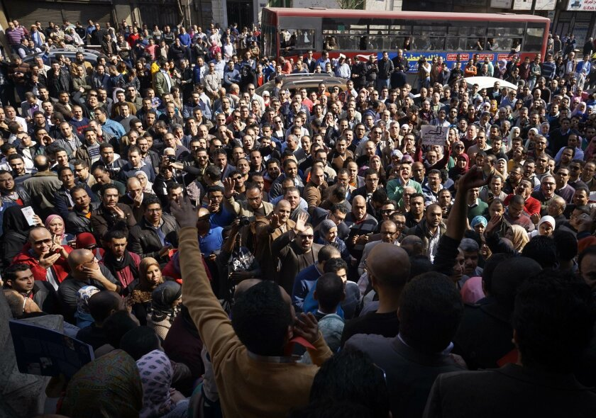 Egyptian doctors stage a protest against rampant police abuses, after two doctors were beaten up by policemen in a Cairo hospital, in front of their headquarters of the Egyptian Medical Syndicate in Cairo, Egypt, Friday, Feb. 12, 2016. Doctors threatened to escalate if the government doesn't hold p
