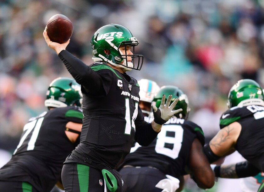 New York Jets quarterback Sam Darnold passes against the Miami Dolphins on Sunday.