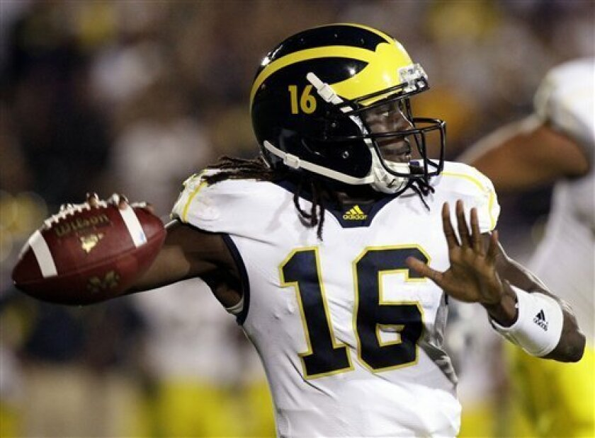 Michigan quarterback Denard Robinson (16) looks to a pass during the second quarter of an NCAA college football game against Northwestern, Saturday, Oct. 8, 2011, in Evanston, Ill. (AP Photo/Nam Y. Huh)