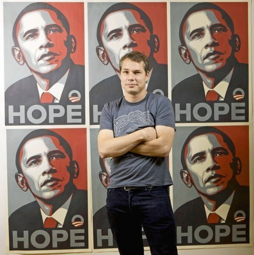 Los Angeles street artist Shepard Fairey poses in front of the Barack Obama Hope artwork he designed in this 2009 photo.