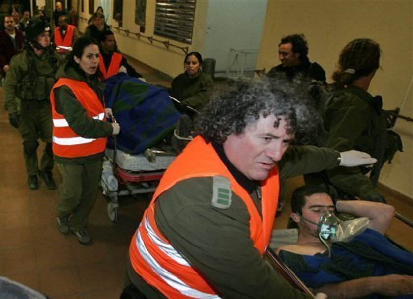 Wounded Israeli soldiers are rushed into Soroka Hospital in the southern Israeli town of Beersheba, Wednesday, Jan. 14, 2009. Israel showed no signs of slowing its bruising 19-day offensive against Gaza's Hamas rulers, striking some 60 targets on Wednesday. Israel launched the onslaught on Dec. 27,