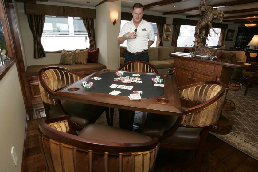 Yacht captain Tyler Flood stood near the game table in the main salon of the 117-foot Crystal II, another of the yachts for sale at YachtFest. The show ends today.