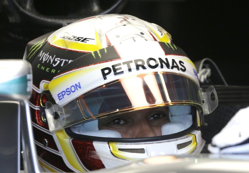 Mercedes driver Lewis Hamilton of Britain in his car during the third free practice at the Monaco racetrack, in Monaco, Saturday, May 28 2016. The Formula one race will be held on Sunday. (AP Photo/Claude Paris)